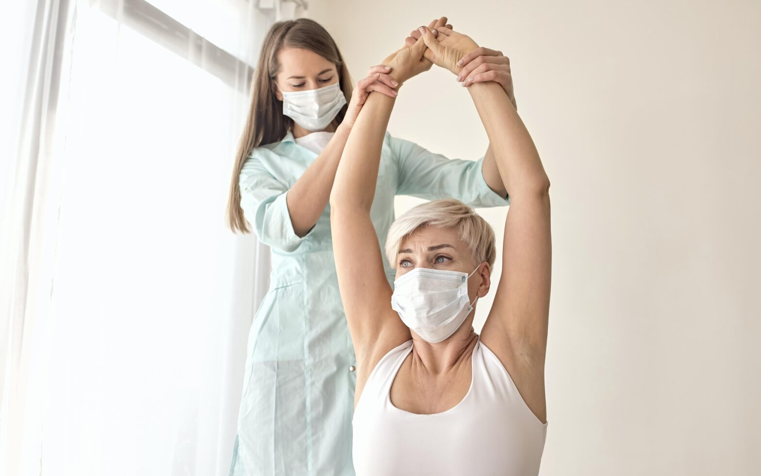 Female Patient Undergoing Therapy With Physiotherapist 1568x980